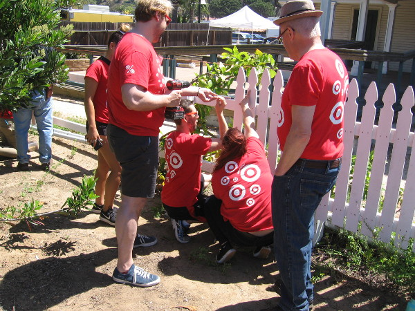 These generous Target employee volunteers were repairing the fence around the McCoy House. Thank you!