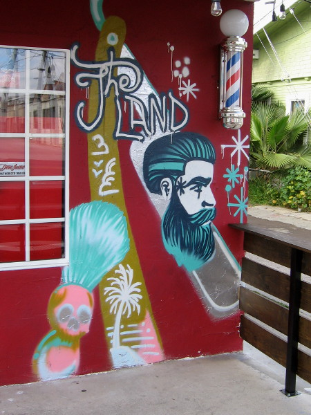 More colorful artwork on the front of The Land Barbershop in North Park.
