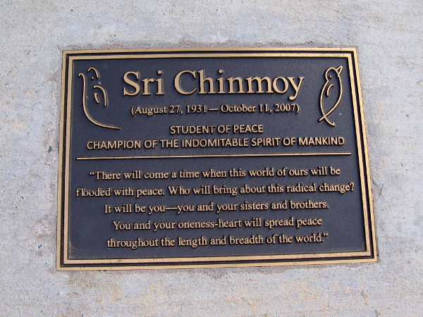Plaque in a small park dedicated to Sri Chinmoy. STUDENT OF PEACE--CHAMPION OF THE INDOMITABLE SPIRIT OF MANKIND