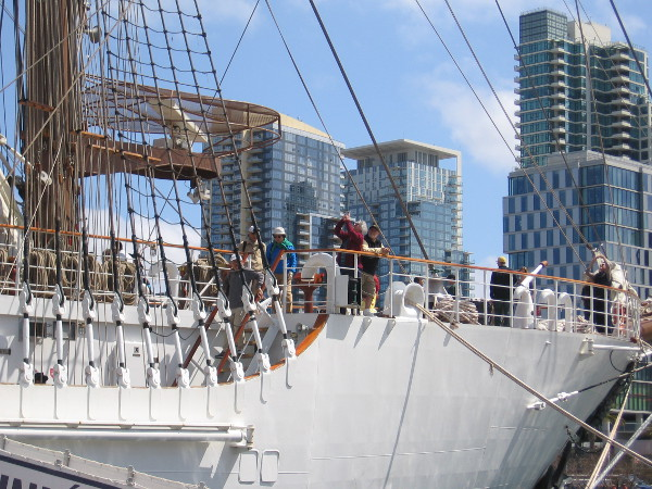 People explore the impressive tall ship during its visit to San Diego's Embarcadero.