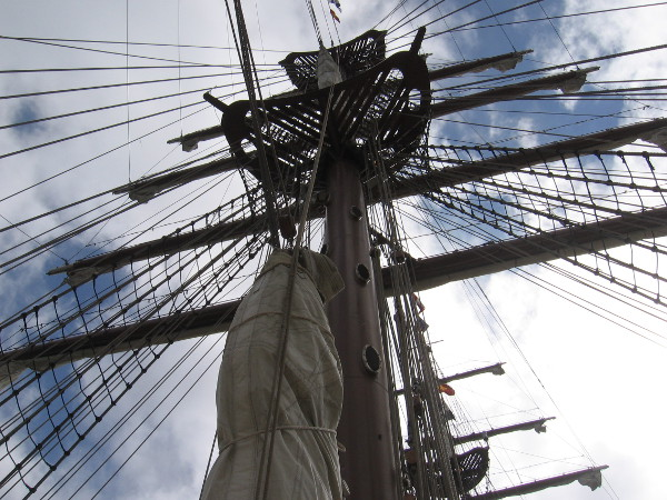 Tilting my head upward to gaze at the tall ship's masts, yards and rigging.