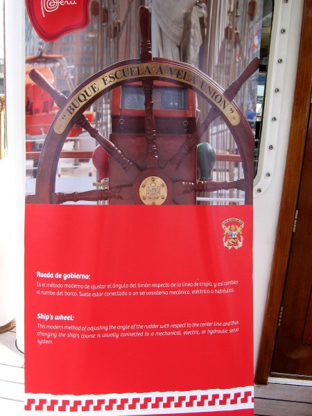 A sign provides a description of the ship's wheel.