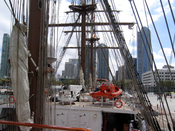 Looking forward along the ship. Many downtown San Diego buildings rise in the background.
