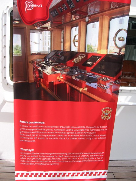 Sign explains the bridge, where modern navigation and steering controls are located. The ship's watch is constant under the command of an officer.
