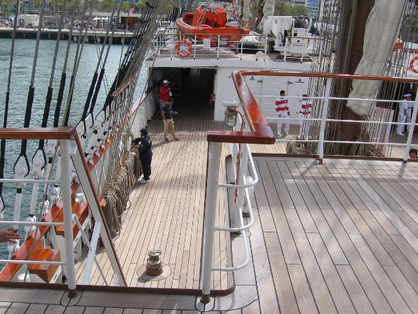 About to descend steps, as I continue forward along the port side of the tall ship.