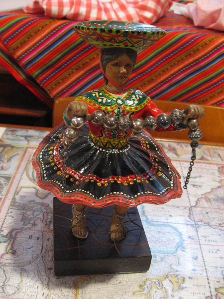 A colorful Peruvian folk art figurine.
