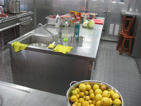 A photo through a window into the ship's kitchen, where Peruvian dishes are prepared for the crew and foreign guests.