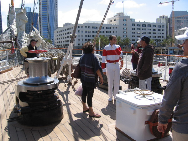 Visitors learn a bit about the tall ship's operation, including how an anchor is lowered.