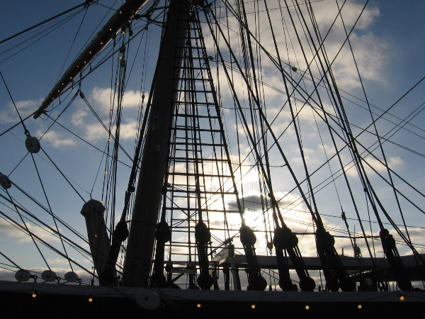 Glowing clouds through the rigging of Star of India.