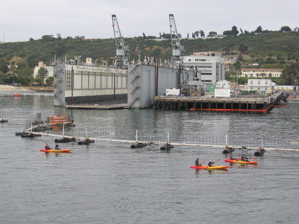 A group of kayakers were passing Naval Base Point Loma, not far from four nuclear submarines.
