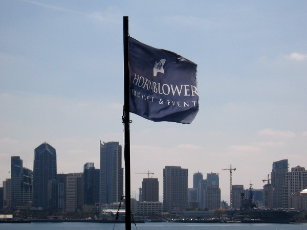 The billowing Hornblower flag and the approaching San Diego skyline.