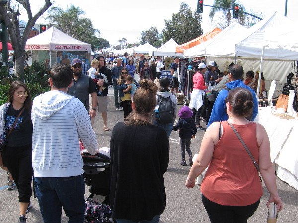 People fill several blocks of scenic Highway 101 and enjoy a fine April weekend at the Encinitas Spring Street Fair.