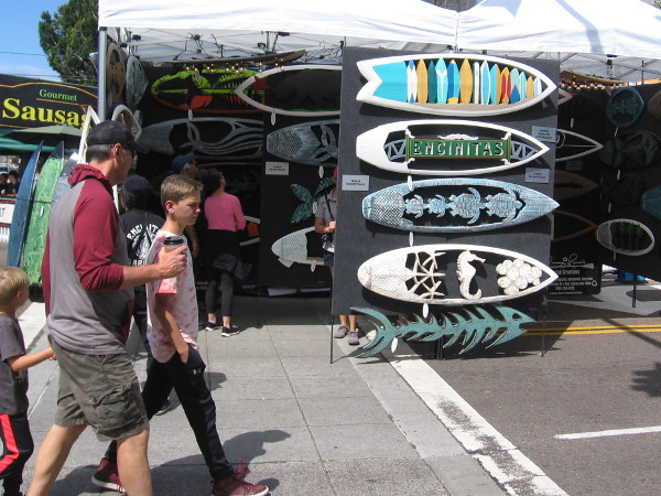 One of these artistic surfboards for sale has Encinitas written on it.