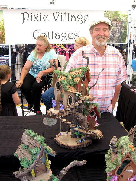 Here's my favorite of the festival. Pixie Village Cottages made from fallen logs by Dennis Patterson. Visit his website pixievillagecottages.com