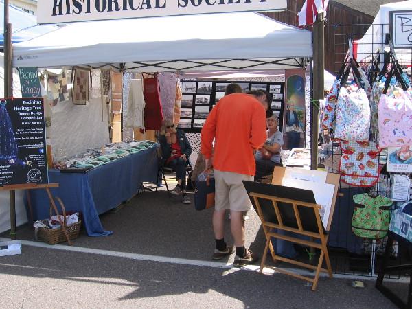 Someone investigates displays at the Encinitas Historical Society tent.