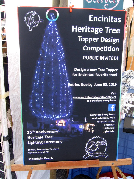 A poster details The 25th Annual Encinitas Heritage Tree Contest! The heritage tree was planted in 1952 above Moonlight Beach.
