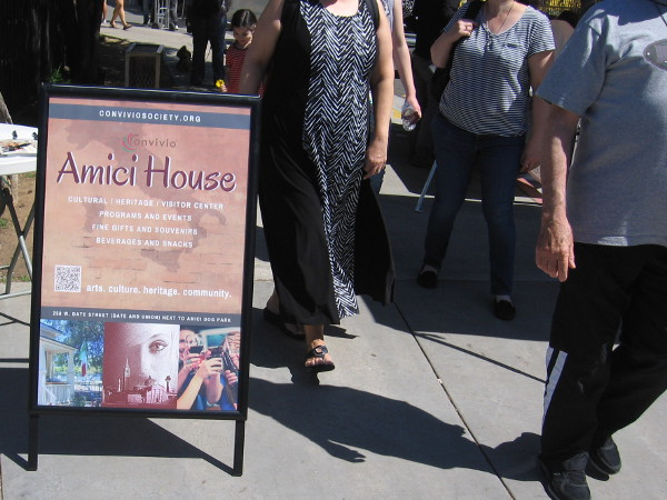 A group of people exits Amici House. I will be able to explore the place during a quiet moment on a Saturday afternoon.