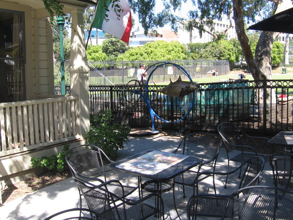 Chairs and tables in front of Amici House provide a pleasant, shady place to relax on a sunny day.