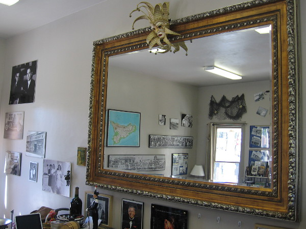 Photo into a large mirror on one wall provides a glimpse of the small museum-like interior.