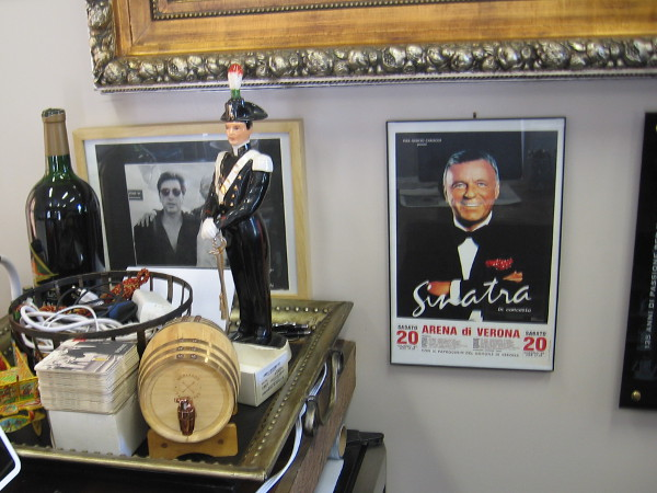 Posters, old photos and works of art with an Italian theme appear on all sides. I see Frank Sinatra.