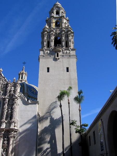 Passing through the California Quadrangle. Palm trees cast shadows on the California Tower.