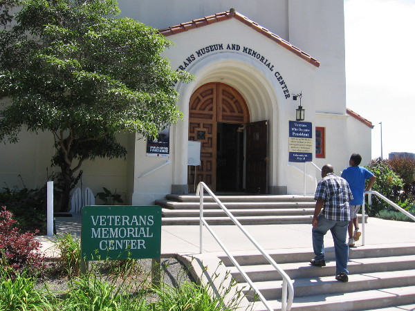 Visitors walk up the front steps of the Veterans Museum and Memorial Center in Balboa Park.
