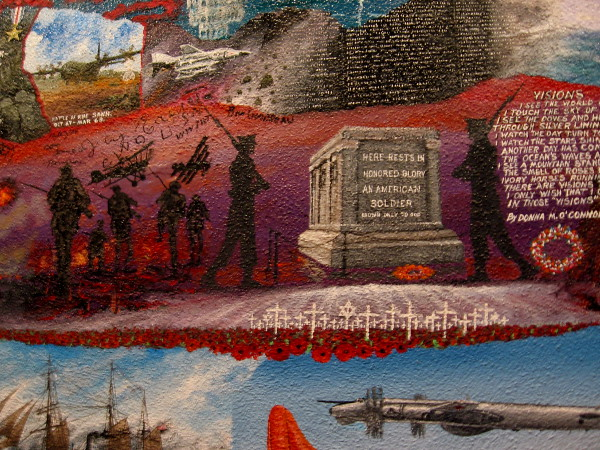 A mural on one wall in the Veterans Museum shows The Tomb of the Unknown Soldier.