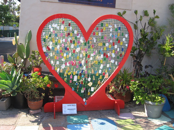 A heart-shaped Love Wall stands on the patio of the Spanish Village Art Center in Balboa Park.