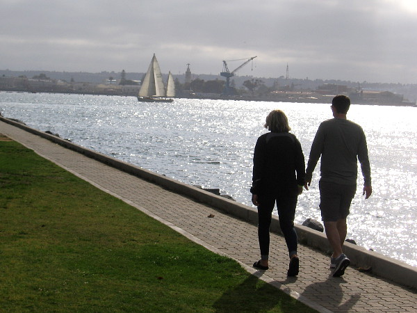 A couple walks along Embarcadero Marina Park North.