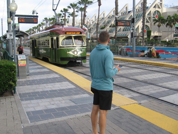 A restored PCC streetcar of the Silver Line arrives at the Convention Center trolley station.