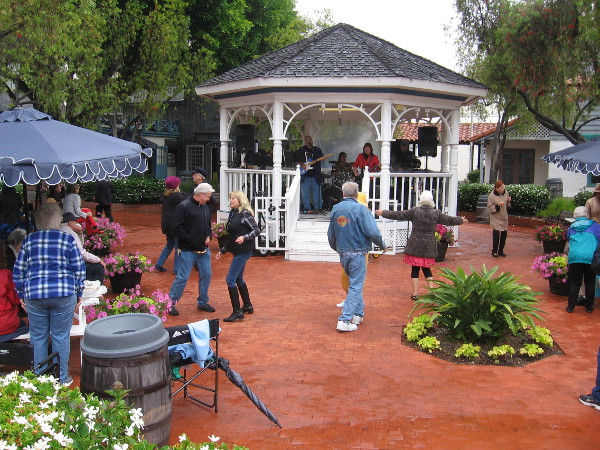 Dancing in the rain--or light, steady showers--by the gazebo in Seaport Village.