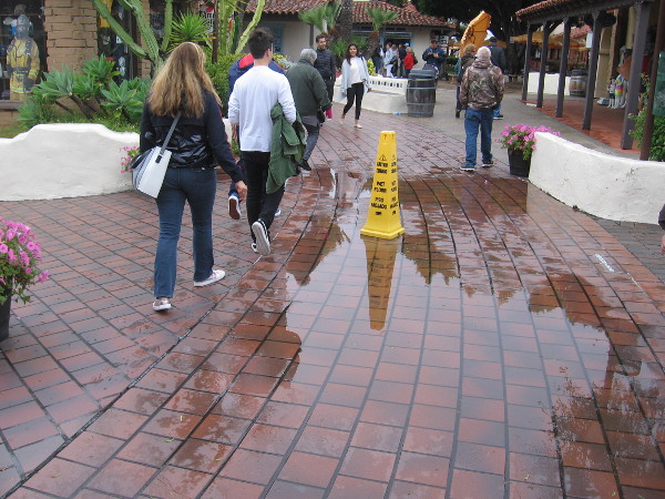 A big puddle awaits a good number of visitors at Seaport Village.