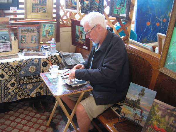 Norm Daniels was getting started on a new piece. He does a lot of plein air painting. His website is NormHere.com
