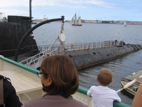 Beyond the museum's Soviet submarine, tall ships sail on San Diego Bay.