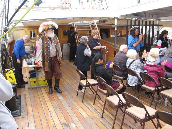 Back on the Star of India, people enjoy live entertainment.