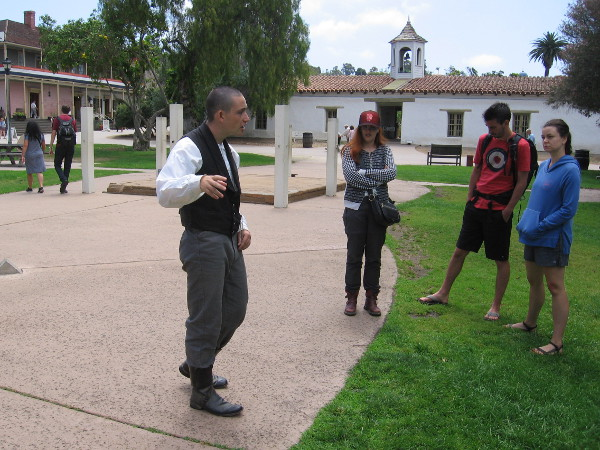 A small group on a free walking tour learns about the history of Old Town San Diego.