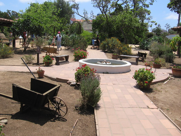 The courtyard of the U-shaped Casa de Estudillo includes a simple fountain at the center.