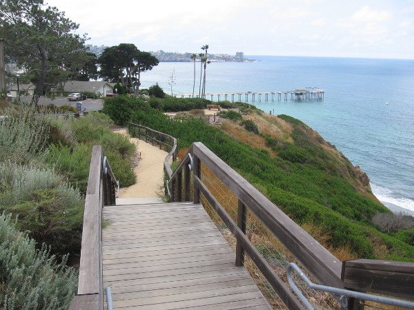 Heading down the wooden walkway with amazing views of the Pacific Ocean, Scripps Pier, and La Jolla Cove in the distance.