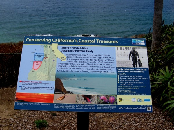 Conserving California's Coastal Treasures. Sign describes Marine Protected Areas. Just offshore is the San Diego-Scripps Coastal SMCA.