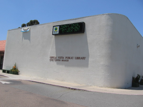 The front of the Chula Vista Public Library, seen from the parking lot entrance.