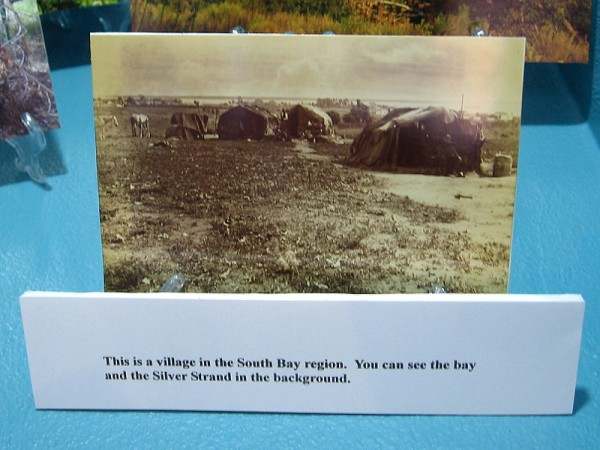 Historical photo of a Kumeyaay village in the South Bay region. San Diego Bay and the Silver Strand are visible in the background.