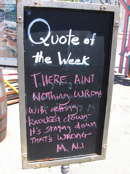 A board features a wise Quote of the Week.