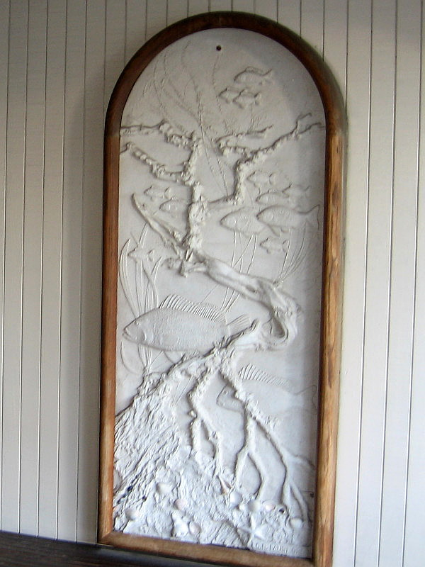 Beautiful relief panel at entrance to the Embarcadero's now closed Anthony's Fish Grotto. An underwater scene.