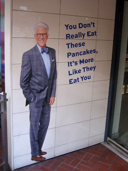 You don't really eat these pancakes, it's more like they eat you. A funny The Good Place quote at the door of Maryjane's restaurant during 2019 Comic-Con.