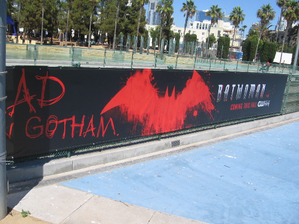 Batwoman banners now adorn the fences along the trolley tracks.