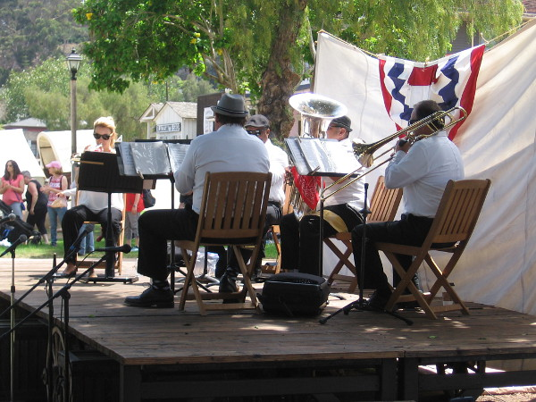 The Westwind Brass Ensemble plays on stage in Old Town San Diego's plaza during an 1800's Fourth of July.
