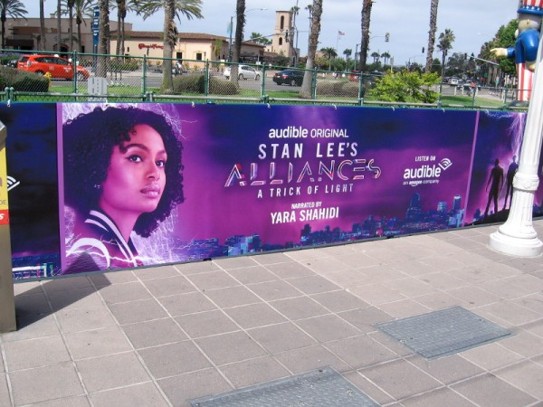 A banner is up near the Seaport Village trolley station promoting Stan Lee's Alliances on Audible.