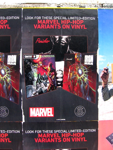 An advertisement slapped on a downtown wall for Marvel Hip-Hop Variants on Vinyl.
