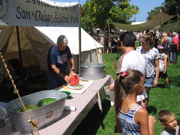 Boosters of Old Town San Diego Historic Park raise money by selling sliced watermelon and pies.
