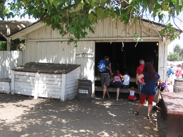 Families were peering into the active blacksmith shop.